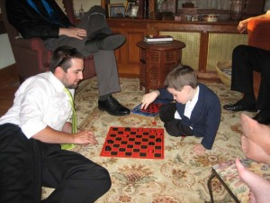 Zack and H. playing checkers
