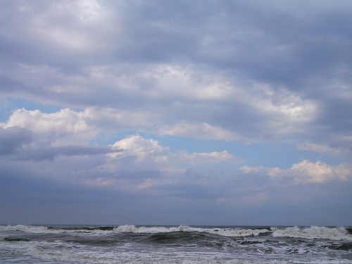 Rough waves under breaking clouds.