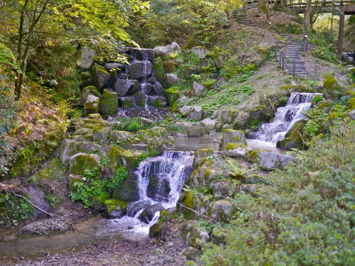 Mountain stream waterfall beside the path.