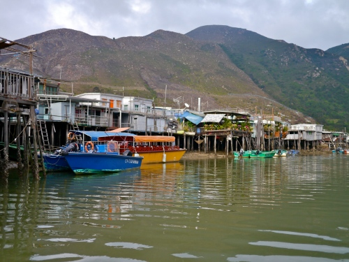 Tai O stilt houses, with personal boats and balcony gardens.
